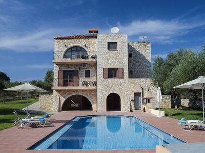 Photo for Τranquil traditional stone villa situated between mountains and sea.
