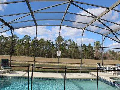 Photo for Beautiful Lake View pool/spa Villa perfect for Large group, 3 miles from Disney