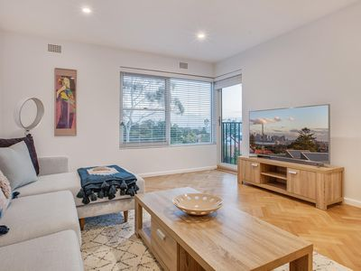 Photo for Sweeping view of city and bridge from stylish pad