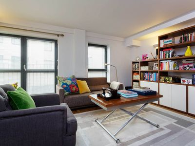 Photo for Contemporary 1BR apartment in Shoreditch, 10 mins from the City, by Veeve