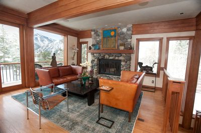The River Rock Fireplace Adds To The Sophistication Of The Living Room