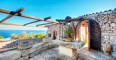 Photo for 7 bd villa, close to rocky cove beaches, created from natural stone