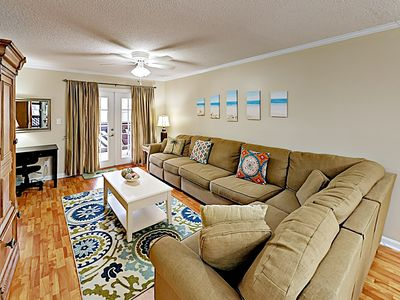 Photo for New Listing! Relaxing Retreat w/ 2 Pools, Hot Tub & Balcony: 1 Block to Beach