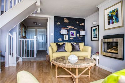 This upstairs living room creates an easygoing coastal feel.
