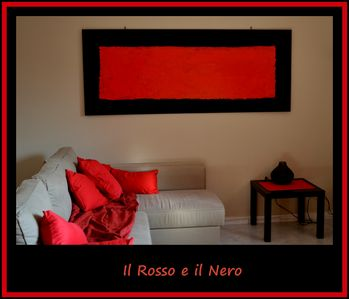 "Photo for ""The Red and the Black"" B & B on the main street of Zafferana"