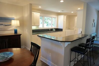 Renovated Greenslake Cottage with open kitchen, picture window  over golf course