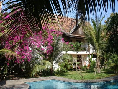 Photo for Anger mysteries your Lodge with swimming pool in the heart of a large tropical garden.