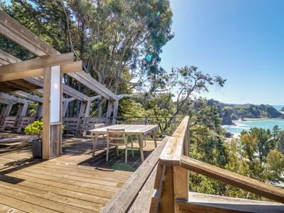 Photo for Oceanfront, blufftop home w/ incredible deck & water views - close to beaches!