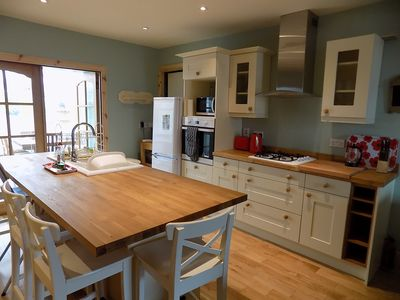 Kitchen with bar stool seating around the island