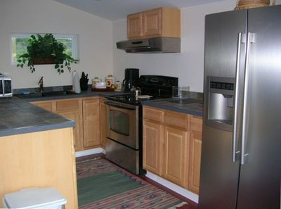 Kitchen with slate & stainless steel appliances - 2 bedroom unit