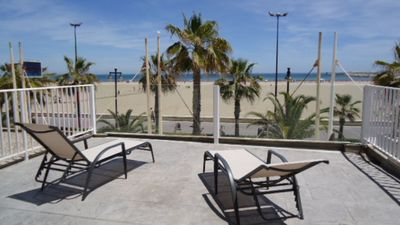 Photo for Apartment with terrace facing the sea, on the beachfront
