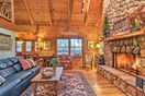 The cabin features cathedral ceilings with exposed wooden beams.