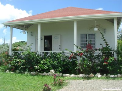 Photo for 2 bedroom cottage with air conditioning close to beach & town - FREE WIFI
