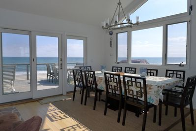 large dining table with seating for 9 and ocean views!