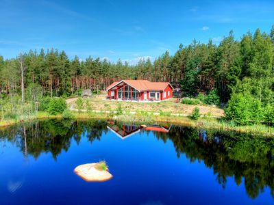 Photo for Dream house on the lake with sauna, fireplace, Wi-Fi, gallery / loft, boat, canoe, double garage