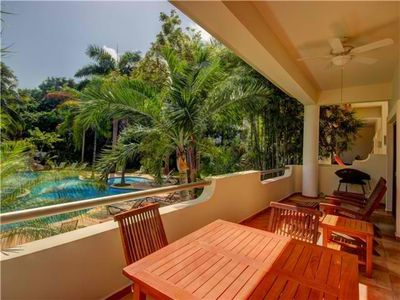 Photo for Garden and pool view. Spacious Balcony. Right on 5th avenue. Palmar CientoDos