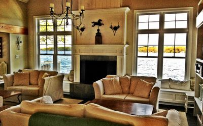 View of open concept living room. Sit & enjoy spectacular views of the lake!