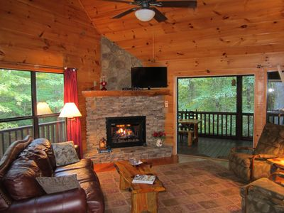 """Living room has stack rock fireplace with gas logs/large windows/40"""" LCD sat. TV"""