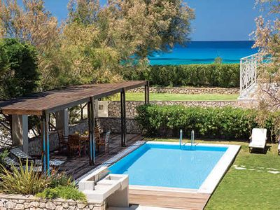 Photo for Beachfront location with restaurants' and shops 5 minutes walk. Sea views. Pretty 2 bedroom villa with private garden and pool.