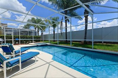View of Pool & Spa. Fence and shrubs give lots of privacy!