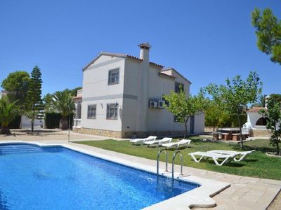 Photo for Large 4 bedroom villa with private pool BBQ air conditioning not overlooked