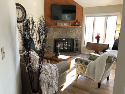 Family room w/ beautiful fireplace.  All fire wood is included & just outside.