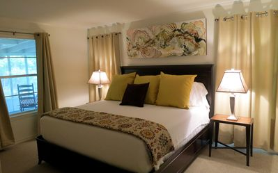 Master Bedroom, king bed, large closets, private bath, woodland views.