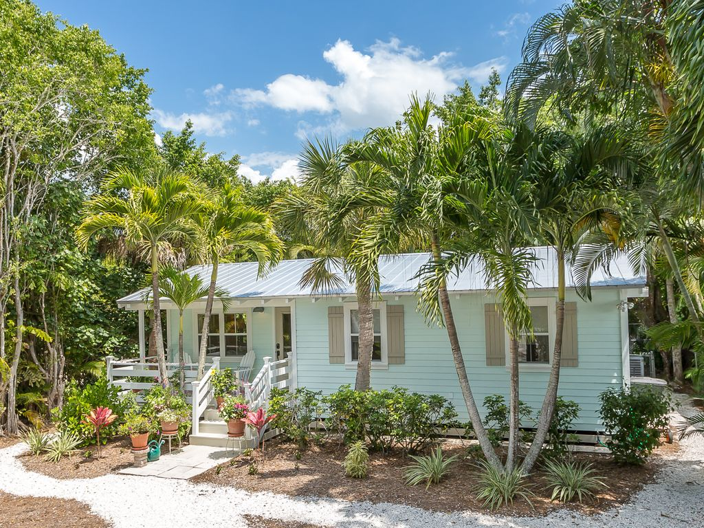 surrounded pin island cottage homeaway sanibel nature by rentals rental