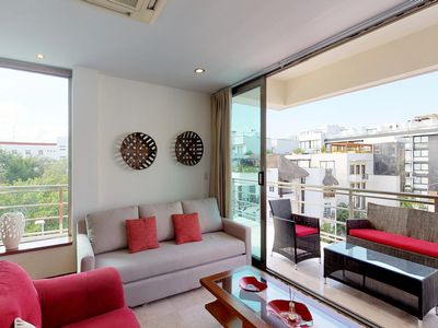 Photo for Modern getaway w/ a furnished balcony, shared, rooftop pool, & great views