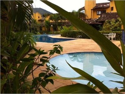 Photo for Chalet in condominium with pools, games room and c / private barbecue.