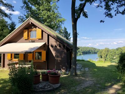 Photo for Log cabin in the Schorfheide directly on Üdersee. Private dock and kayak.