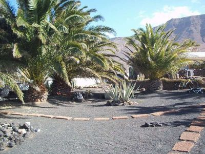 Photo for Bungalow BELLATERE in Famara for 3 persons with terrass, garden, balcony, views to the ocean, views of the volcanoes, WIFI on the go and less than 500m to the sea