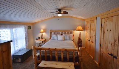 2nd guest room with queen log bed and lake view