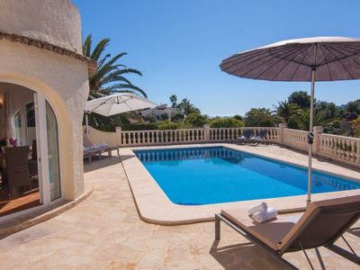 Photo for 4 bedroom Villa, sleeps 8 in Urbanització Montemar with Pool, Air Con and WiFi