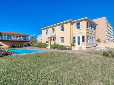 Photo for Special Reduced! Secluded beach Resort in town across from 9 eateries Sleeps +12