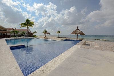 Relax at Costa del Sol's Infinity pool with shallow end perfect for kids