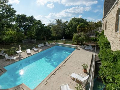 Photo for Beautiful restored French castle with pool and garden, next to Golf resort