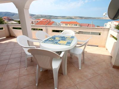 Photo for Two bedroom apartment with terrace and sea view Kustići, Pag (A-6320-a)