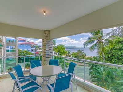 Photo for Sea-views central condo with pool, BBQ. Guest-friendly, near sandy beach!