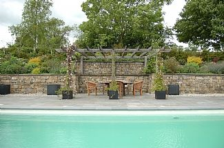 Heated outdoor pool available June, July & August, with terrace seating