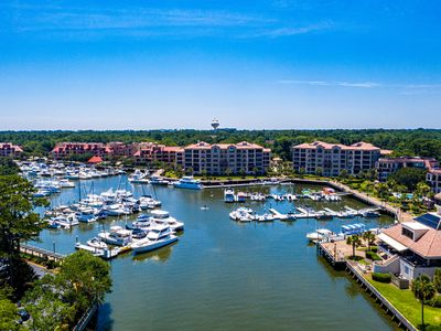 Photo for Late Summer Special! Penthouse condo steps from dining, shopping and marina!