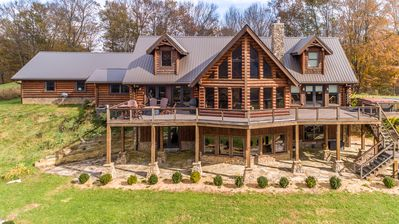 Photo for Mountain Paradise: Stunning Log home on 100 acres, 5 miles of trails, river frontage, lake