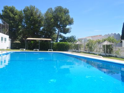 Photo for Apartment Girasol with large terrace, BBQ, WIFI, swimming pool, tennis court