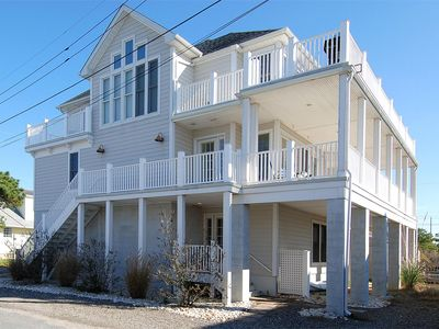 Photo for FREE DAILY ACTIVITIES!!! BEAUTIFUL!  Wonderful multi-level 7 bedroom, 5.5 bath home located one house from the Assawoman Bay offering panoramic views and glorious sunsets from the many decks!
