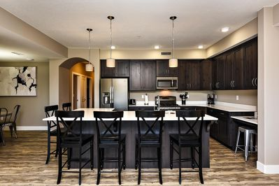 Open Kitchen with large screen Tv viewing, free wifi, and dining table (on left)