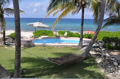 Relax in a comfy hammock/by the pool &listen to the waves or your favorite tunes