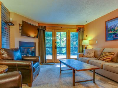 Photo for Comfy riverfront condo w/ shared pool & sauna - walk to ski lifts!