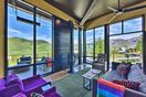 There are spectacular mountain views from the floor-to-ceiling windows.