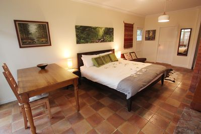 King size bed with lots of space for dining table and relaxing couch area