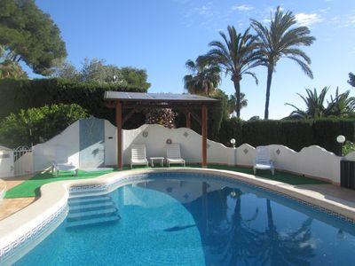 Photo for private kidney shapped  pool,  tennis court and Garden